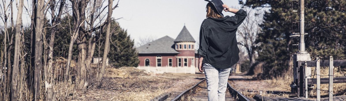 Women On Railroad Tracks (2)